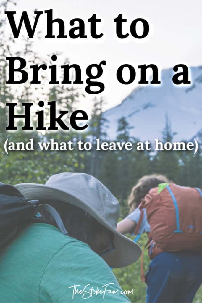 image of boy and father hiking with orange backpack on and a text overlay that says: what you need to go hiking and what to leave at home